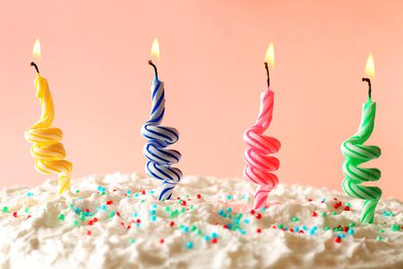 47403314 - birthday cake with candles on color background