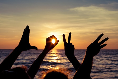 35572460 - love  sign language at the sunset time