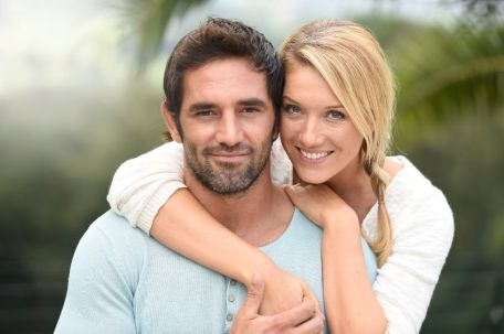 67043460 - attractive couple embracing each other